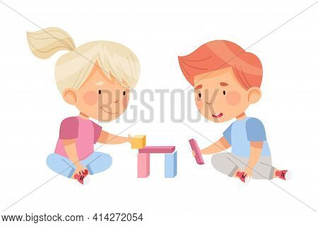 Excited Boy And Girl Sitting On The Floor In Nursery Playing Toy Blocks Vector Illustration