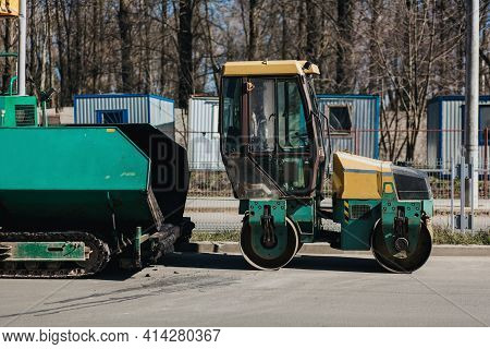 Heavy Vibratory Roller Compactor Working On Asphalt Pavement At Road Repairing