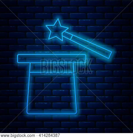 Glowing Neon Line Magic Hat And Wand Icon Isolated On Brick Wall Background. Magic Trick. Mystery En