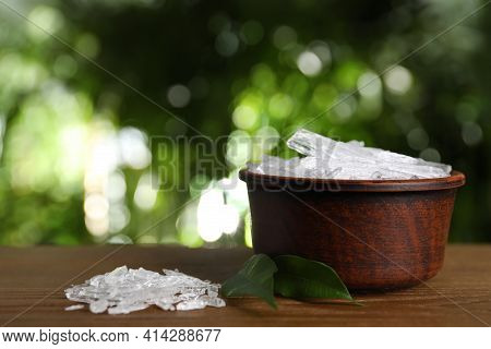 Menthol Crystals And Green Leaves On Wooden Table Against Blurred Background. Space For Text