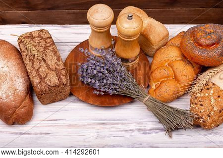 Fresh Homemade Italian Bread. Rural Breakfast With Fresh Bread. Composition With Tasty Lavender Baki