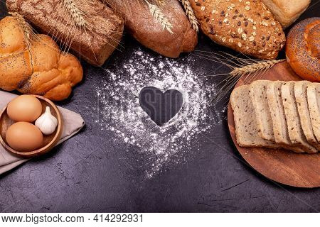 Heart Of Flour, White Bread. Love Cooking. Various Of Rye Bread On A Dark Background. Copy Space For
