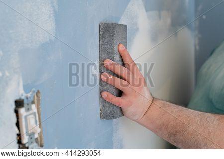 Sanding Gypsum Plaster By Hand Using Sandpaper Wall Professional