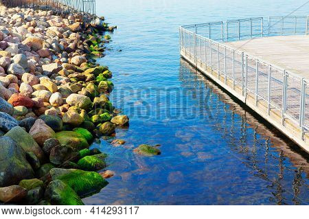 Seaside Boulders And Berth Balustrade . Stones On The Baltic Sea Coast