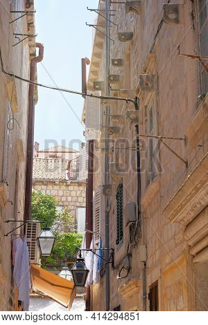 Between Walls Of Houses. Passage Between Walls To The Old Town, The Historical Part Of The City. Sum