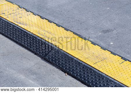 Yellow And Black High Voltage Street Cable Protector