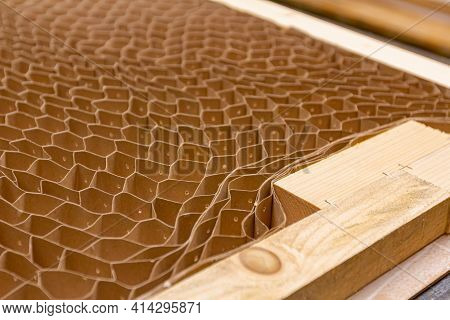 Perforated Pasteboard For Soundproof Insulating Door Is In The Carpentry Workshop.