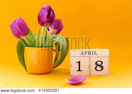 Calendar For April 18: Cubes With The Number 18 , The Name Of The Month April In English, A Bouquet