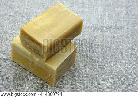 Laundry Soap On Linen. Two Pieces Of Brown Natural Soap On A Gray Background. Rectangular Laundry So