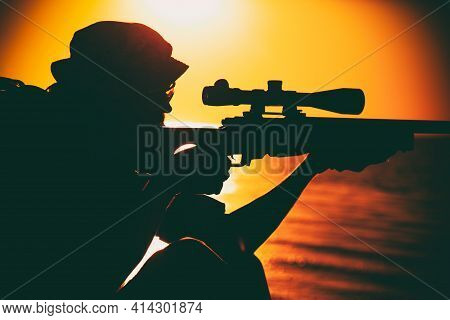 Commando Team Sniper, Army Special Forces Shooter Aiming, Shooting Sniper Rifle While Sitting On Sea