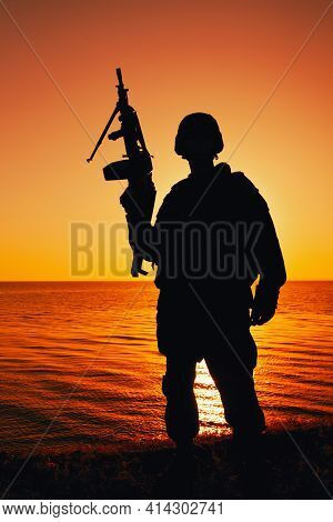 Silhouette Of Army Soldier, Special Operations Shooter Armed Light Machine Gun Standing On Backgroun