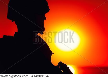 Shoulder Silhouette Of Army Soldier, Special Operations Forces Fighter In Combat Helmet And Ballisti