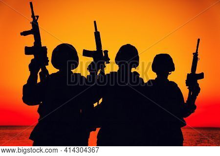 Silhouette Of Army Special Operations Forces Soldiers Team, Group Of Marines Or Coast Guard Fighters