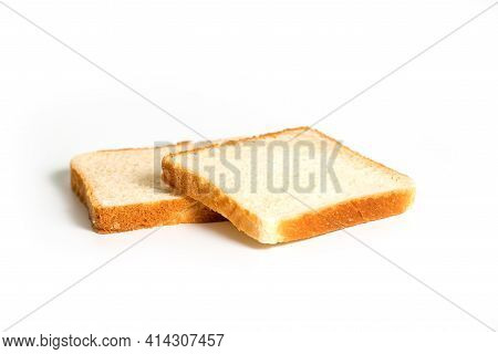 Two Slices Of White Bread Toast Isolated On White