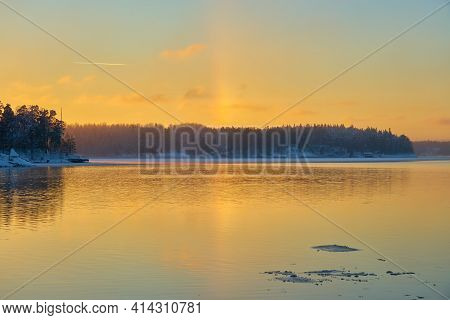 The Halo Effect On The Shores Of The Freezing Sea In Turku, Finland. Copy Space.