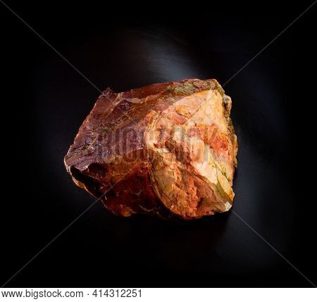 Red Beautiful Jasper Mineral Crystal From Orsk, Ural, Russia. A Photo Of A Stone Isolated On Black.