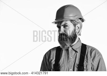 Renovation Concept. Mechanic Perform Technical Work. Bearded Mature Man In Uniform. Reputation Of Ex