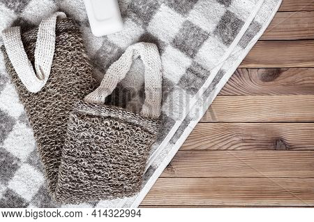 Accessories For Visiting The Bath Or Sauna On A Wooden Background: Towel, Washcloth. Top View With C
