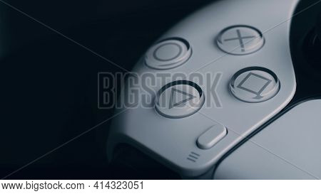 Moscow, Russia - March 12 2021: Wireless White Gamepad Playstation 5 On Black Background. Spinning I