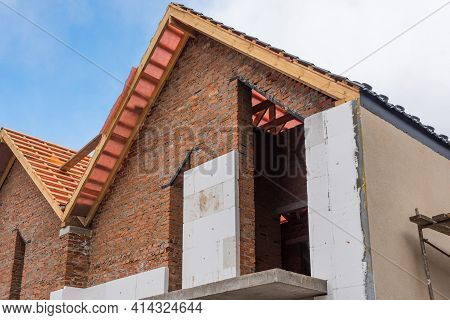 Unfinished House Of Brick, Still Under Construction, Installing Roof, Wall Insulation.