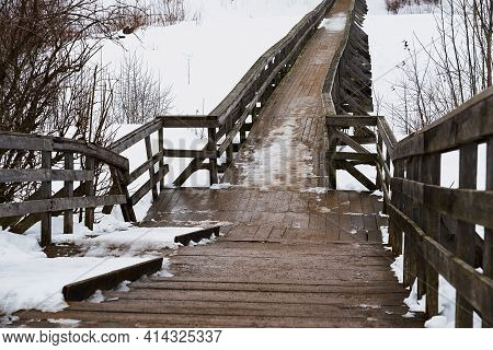Abstract Empty Old And Vintage Wooden Bridge Closeup And Snow In Winter Or Spring