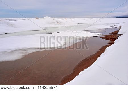Abstract Spring Landscape Of A Winter Northern Or Arctic Surface Of Big Water Space Close Up For A N
