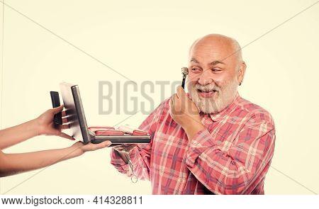 Experienced Barber Appreciate High Quality Barber Equipment. Man Senior Bearded Handsome Barber Use