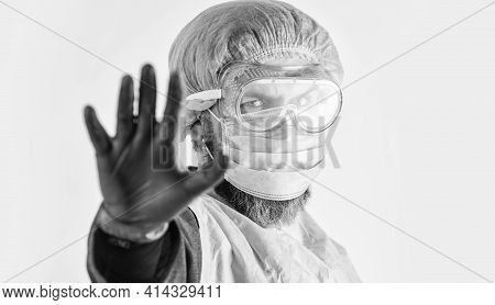 Personal Protective Equipment. Man Wearing Protective Mask. Coronavirus Pandemic. Garments Placed To