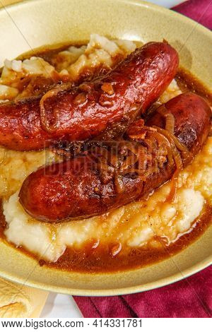 British Bangers And Mash Sausage And Mashed Potatoes With Onion Gravy