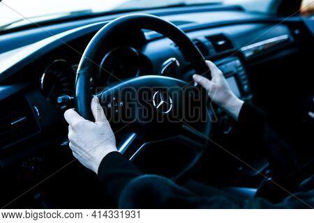 Dnepropetrovsk, Ukraine - 03.15.2021: Car Mercedes-benz R 350. Woman Driving A Car. Women's Hands Ho