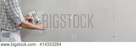 Closeup Hands Man Drywall Worker Or Plasterer Putting Stucco On Plasterboard Wall Using A Trowel And
