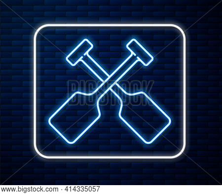 Glowing Neon Line Paddle Icon Isolated On Brick Wall Background. Paddle Boat Oars. Vector