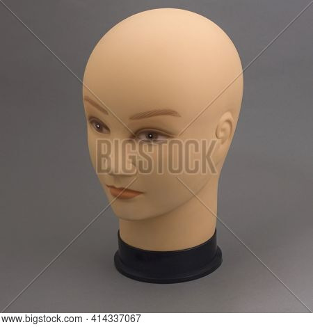 Mannequin Full Face Of Head Of Young White Woman Without Hair On Grey Background. Shop Concept, Sale