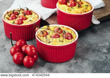 Mini Quiche Pie With Chicken Meat, Cheese And Tomatoes In Baking Cups.