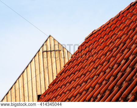 Details Of Houses In A German Village With A Tiled Roof And A Gable Covered With Wooden Planks