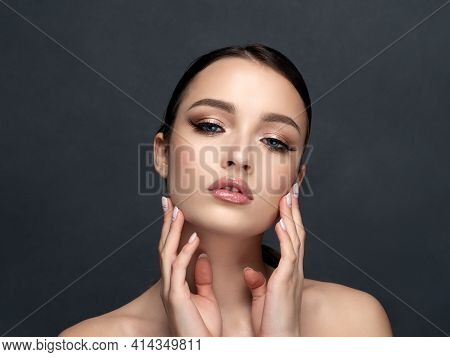 Portrait Of Young Beautiful Woman Touching Her Face. Cleaning Skin, Spa Therapy, Skincare, Cosmetolo