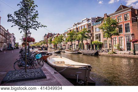 Leiden, The Netherlands - June 27, 2018: Boats Parked Along Canal In Leiden, The Netherlands. Bunch