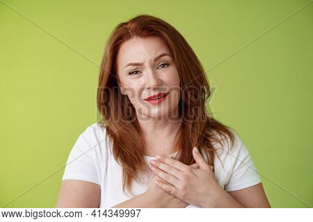Story Touched Lady Heart. Tender Impressed Middle-aged Redhead Woman Press Palms Chest Sighing Happi