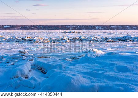 Winter View Of The Quebec With A Sunset On The Frozen St. Lawrence River At Neuville