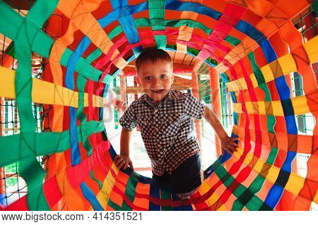 Boy Playing On The Playground, In The Childrens Maze. Childrens Labyrinth.
