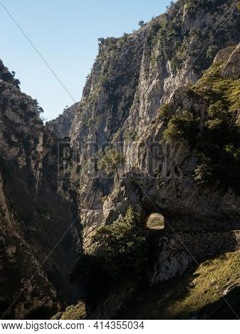 Natural Tunnel Hole On Gorge Valley Canyon Hiking Trail Path Route Senda Del Cares In Picos De Europ