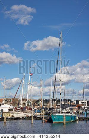Urk, The Netherlands - March 19, 2021: Sailing Ships Moored In Harbor Dutch Village Urk