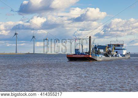 Urk, The Netherlands - March 19, 2021: Dredge Ship At Dutch Sea Ijsselmeer Near Coast With Big Wind