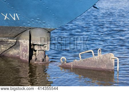 Moored Steel Ship In Harbor With Detail Rudder Which Needs Maintenance
