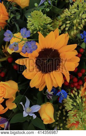 Sunflowers in a yellow and blue wedding arrangement