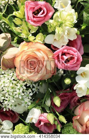 Pink And White Flowers In A Mixed Flower Wedding Centerpiece