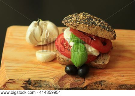 Italian Caprese Sandwiches With Fresh Tomatoes, Mozzarella Cheese And Basil