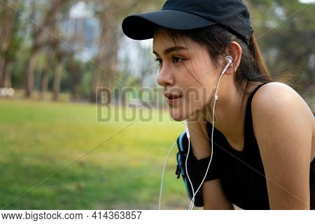 Portrait Of Athletic Young Women After Run. Women Resting After Jogging At The Park. Young Women Wea