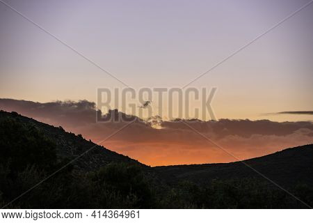 Sunlight Just Before It Breaks The Horizon In Black Canyon Of The Gunnison National Park