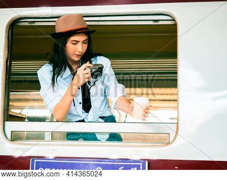 Travel Concept.beautiful Traveller Girl In Train Station.backpacker Pretty Woman Wear Hat Take Photo